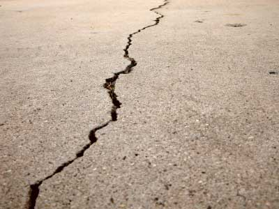 Cracked concrete. We offer concrete repair and maintenance for your commercial properties.